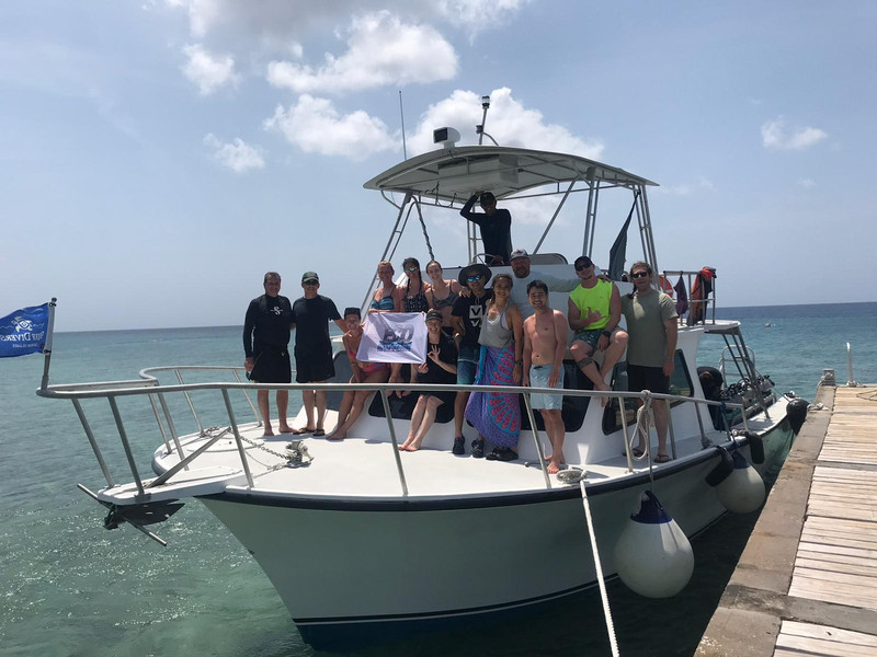 Group photo aboard boat during Grand Cayman dive trip 2019